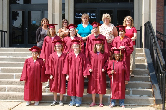 Nine ISVI grads joined by school officials
