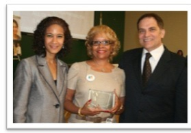 IDHS Secretary Saddler and IDHR Director Claps present Wanda Bethel Satkas with the Advocate of the Year Award.
