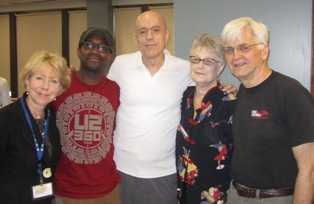 Pictured from left: C4 CEO Eileen Durkin, Coleman Good, Office of State Rep. Greg Harris; Harris; Joyce Dugan, C4 Board Chair with husbandTim Dugan.