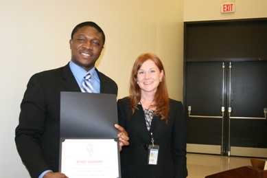 Benro Ogunyipe(left), now working in the Office of Accessibility & Customer Support, recieved an award from the ICED in the employee category from Elizabeth Gastellum, Office of Lietenant Governor.