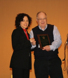Dr. Gloria Wong (L) receives the 2012 Outstanding Audiology Award from IDHS DRS
