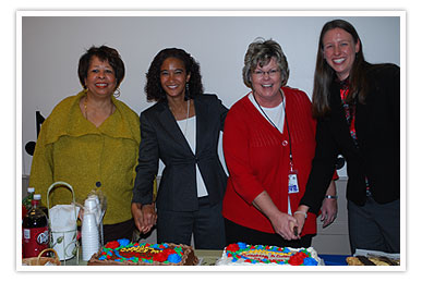 Donna Clay, Secretary Saddler, Linda Saterfield and Jennifer Wagner cut the cake at the Local Office Pride kick off celebration January 11 at the Woodlawn FCRC.
